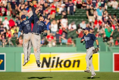 BOSTON, MA - APRIL 21: Brandon Guyer #5, Steven Souza Jr. #20, and Kevin Kiermaier #39 of the Tampa Bay Rays celebrate a victory against the Boston Red Sox on April 21, 2016 at Fenway Park in Boston, Massachusetts . (Photo by Billie Weiss/Boston Red Sox/Getty Images) *** Local Caption *** Brandon Guyer; Steven Souza Jr.; Kevin Kiermaier