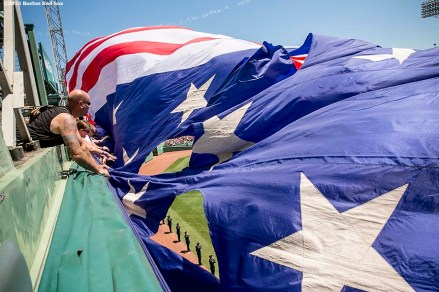 BOSTON, MA - JULY 4: The American flag is dropped over the Green Monster before a game between the Boston Red Sox and the Texas Rangers on July 4, 2016 at Fenway Park in Boston, Massachusetts. (Photo by Billie Weiss/Boston Red Sox/Getty Images) *** Local Caption ***
