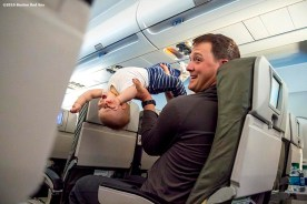 July 10, 2016, Boston, MA: Boston Red Sox pitcher Steven Wright plays with his son Lucas on the plane in Boston, Massachusetts Sunday, July 10, 2016 during a team charter flight to San Diego, California for the 2016 Major League Baseball All-Star Game. (Photos by Billie Weiss/Boston Red Sox)
