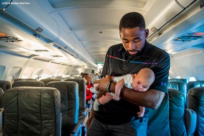 July 10, 2016, Boston, MA: Boston Red Sox center fielder Jackie Bradley Jr. holds his daughter Emerson on the plane in Boston, Massachusetts Sunday, July 10, 2016 during a team charter flight to San Diego, California for the 2016 Major League Baseball All-Star Game. (Photos by Billie Weiss/Boston Red Sox)