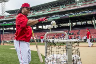 BOSTON, MA - JULY 25: Michael Martinez #40 of the Boston Red Sox tosses balls into the basket before a game against the Detroit Tigers on July 25, 2016 at Fenway Park in Boston, Massachusetts. (Photo by Billie Weiss/Boston Red Sox/Getty Images) *** Local Caption *** Michael Martinez