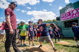July 26, 2016, Boston, MA: Boston Red Sox pitcher Robbie Ross Jr. watches as kids participate in a pitching drill during a Sox Talk clinic with the T-Mobile Mobile Red Sox Showcase Truck at Billings Field in West Roxbury, Massachusetts Tuesday, July 26, 2016. (Photo by Billie Weiss/Boston Red Sox)