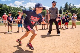 July 26, 2016, Boston, MA: Boston Red Sox catcher Blake Swihart watches as kids participate in a base running drill during a Sox Talk clinic with the T-Mobile Mobile Red Sox Showcase Truck at Billings Field in West Roxbury, Massachusetts Tuesday, July 26, 2016. (Photo by Billie Weiss/Boston Red Sox)