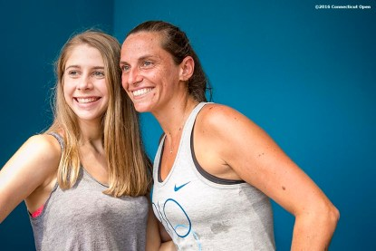 August 21, 2016, New Haven, Connecticut: Roberta Vinci of Italy poses with a fan during a Box Holder meet and greet during WTA All-Access Hour on Day 3 of the 2016 Connecticut Open at the Yale University Tennis Center on Sunday, August 21, 2016 in New Haven, Connecticut. (Photo by Billie Weiss/Connecticut Open)