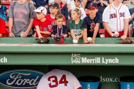 BOSTON, MA - AUGUST 30: Fans look on as David Ortiz #34 of the Boston Red Sox gets ready in the dugout before a game against the Tampa Bay Rays on August 30, 2016 at Fenway Park in Boston, Massachusetts. (Photo by Billie Weiss/Boston Red Sox/Getty Images) *** Local Caption *** David Ortiz