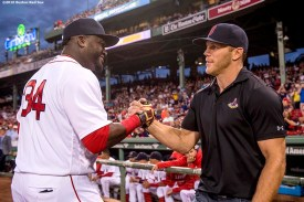 BOSTON, MA - SEPTEMBER 14: David Ortiz #34 of the Boston Red Sox high fives former Boston Bruins player Sean Thornton before a game against the Baltimore Orioles on September 14, 2016 at Fenway Park in Boston, Massachusetts. (Photo by Billie Weiss/Boston Red Sox/Getty Images) *** Local Caption *** Sean Thornton; David Ortiz