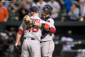 BALTIMORE, MD - SEPTEMBER 21: Craig Kimbrel #46 and Sandy Leon #3 of the Boston Red Sox celebrate a victory against the Baltimore Orioles on September 21, 2016 at Oriole Park at Camden Yards in Baltimore, Maryland. (Photo by Billie Weiss/Boston Red Sox/Getty Images) *** Local Caption *** Craig Kimbrel; Sandy Leon
