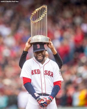 BOSTON, MA - OCTOBER 2: Former Boston Red Sox pitcher Pedro Martinez puts the 2004 World Series trophy on top of David Ortiz #34 of the Boston Red Sox during an honorary retirement ceremony in his final regular season game at Fenway Park against the Toronto Blue Jays on October 2, 2016 at Fenway Park in Boston, Massachusetts. (Photo by Billie Weiss/Boston Red Sox/Getty Images) *** Local Caption *** David Ortiz; Pedro Martinez
