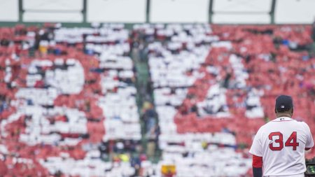 BOSTON, MA - OCTOBER 2: David Ortiz #34 of the Boston Red Sox looks on as fans hold up cards to form a number 34 in the outfield bleachers during an honorary retirement ceremony in his final regular season game at Fenway Park against the Toronto Blue Jays on October 2, 2016 at Fenway Park in Boston, Massachusetts. (Photo by Billie Weiss/Boston Red Sox/Getty Images) *** Local Caption *** David Ortiz