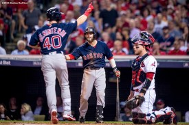 CLEVELAND, OH - OCTOBER 6: Andrew Benintendi #40 of the Boston Red Sox reacts with Dustin Pedroia #15 after hitting a solo home run during the third inning of game one of the American League Division Series against the Cleveland Indians on October 6, 2016 at Progressive Field in Cleveland, Ohio. (Photo by Billie Weiss/Boston Red Sox/Getty Images) *** Local Caption *** Andrew Benintendi; Dustin Pedroia