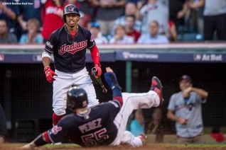 CLEVELAND, OH - OCTOBER 7: Roberto Perez #55 of the Cleveland Indians scores as Francisco Lindor #12 reacts during the fourth inning of game two of the American League Division Series against the Boston Red Sox on October 7, 2016 at Progressive Field in Cleveland, Ohio. (Photo by Billie Weiss/Boston Red Sox/Getty Images) *** Local Caption *** Francisco Lindor; Roberto Perez