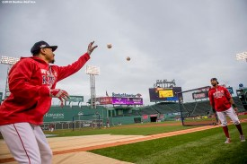 BOSTON, MA - OCTOBER 8: Chris Young #30 and Mookie Betts #50 of the Boston Red Sox toss baseballs during a workout before game three of the American League Division Series against the Cleveland Indians on October 8, 2016 at Fenway Park in Boston, Massachusetts. (Photo by Billie Weiss/Boston Red Sox/Getty Images) *** Local Caption *** Chris Young; Mookie Betts