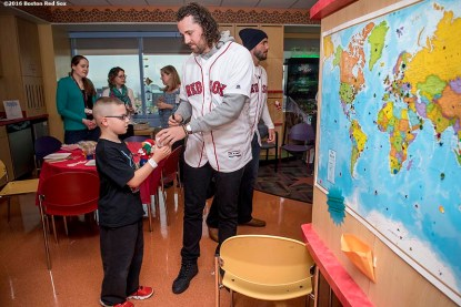 """""""Boston Red Sox pitcher Heath Hembree greets a patient during a visit to Massachusetts General Hospital as part of the 2016 Holiday Caravan in Boston, Massachusetts Thursday, December 8, 2016."""""""
