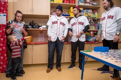 """""""A young patient plays catch with Boston Red Sox pitcher Robby Scott, infielder Deven Marrero, and pitcher Heath Hembree during a visit to Massachusetts General Hospital as part of the 2016 Holiday Caravan in Boston, Massachusetts Thursday, December 8, 2016."""""""