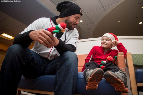 """""""Boston Red Sox pitcher Robby Scott greets a patient during a visit to The Jimmy Fund at Dana-Farber Cancer Institute as part of the 2016 Holiday Caravan in Boston, Massachusetts Friday, December 9, 2016."""""""
