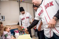 """""""Boston Red Sox infielder Deven Marrero and pitchers Robby Scott and Heath Hembree greet a patient during a visit to Boston Children's Hospital as part of the 2016 Holiday Caravan in Boston, Massachusetts Friday, December 9, 2016."""""""