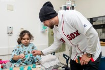 """""""Boston Red Sox infielder Deven Marrero greets a patient during a visit to Boston Children's Hospital as part of the 2016 Holiday Caravan in Boston, Massachusetts Friday, December 9, 2016."""""""