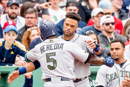 BOSTON, MA - MAY 28: Guillermo Heredia #5 of the Seattle Mariners hugs Robinson Cano #22 after hitting a solo home run during the seventh inning of a game against the Boston Red Sox on May 28, 2017 at Fenway Park in Boston, Massachusetts. (Photo by Billie Weiss/Boston Red Sox/Getty Images) *** Local Caption *** Guillermo Heredia; Robinson Cano