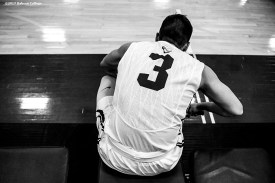 November 30, 2016, Newton, MA: Sam Bohmiller ties his shoes before a game against Bates University at Webster Sports Arena at Babson College in Newton, Massachusetts Wednesday, November 30, 2016. (Photo by Billie Weiss/Babson College Magazine)