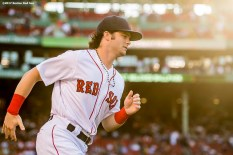 BOSTON, MA - JUNE 9: Andrew Benintendi #16 of the Boston Red Sox warms up before a game against the Detroit Tigers on June 9, 2017 at Fenway Park in Boston, Massachusetts. (Photo by Billie Weiss/Boston Red Sox/Getty Images) *** Local Caption *** Andrew Benintendi