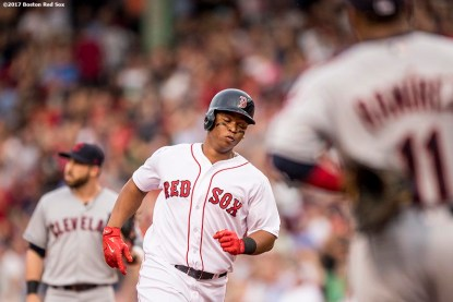 BOSTON, MA - AUGUST 14: Rafael Devers #11 of the Boston Red Sox rounds the bases after hitting a solo home run during the second inning of a game against the Cleveland Indians on August 14, 2017 at Fenway Park in Boston, Massachusetts. (Photo by Billie Weiss/Boston Red Sox/Getty Images) *** Local Caption *** Rafael Devers
