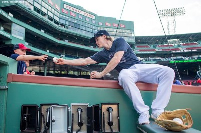 BOSTON, MA - AUGUST 16: Brock Holt #12 of the Boston Red Sox signs autographs for patients of the Jimmy Fund before a game against the St. Louis Cardinals on August 16, 2017 at Fenway Park in Boston, Massachusetts. (Photo by Billie Weiss/Boston Red Sox/Getty Images) *** Local Caption *** Brock Holt