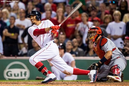 BOSTON, MA - AUGUST 16: Mookie Betts #50 of the Boston Red Sox hits the game winning walk-off double during the ninth inning of a game against the St. Louis Cardinals on August 16, 2017 at Fenway Park in Boston, Massachusetts. (Photo by Billie Weiss/Boston Red Sox/Getty Images) *** Local Caption *** Mookie Betts