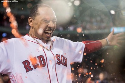 BOSTON, MA - AUGUST 16: Mookie Betts #50 of the Boston Red Sox is doused with Powerade after hitting the game winning walk-off double during the ninth inning of a game against the St. Louis Cardinals on August 16, 2017 at Fenway Park in Boston, Massachusetts. (Photo by Billie Weiss/Boston Red Sox/Getty Images) *** Local Caption *** Mookie Betts