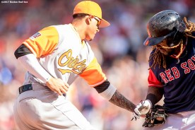 BOSTON, MA - AUGUST 27: Hanley Ramirez #13 of the Boston Red Sox evades the tag of Manny Machado #13 of the Baltimore Orioles as he advances to third base during the seventh inning of a game on August 27, 2017 at Fenway Park in Boston, Massachusetts. (Photo by Billie Weiss/Boston Red Sox/Getty Images) *** Local Caption *** Manny Machado; Hanley Ramirez