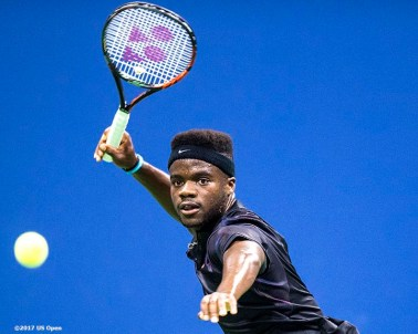 August 29, 2017, New York City, NY: Frances Tiafoe in action during a match against Roger Federer during the 2017 US Open Tennis Championships at the Billie Jean King National Tennis Center in New York, New York Tuesday, August 29, 2017. (Photo by Billie Weiss/US Open Tennis Championships)