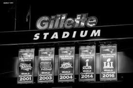 Five Super Bowl banners are displayed before the opening game of the 2017 NFL season between the New England Patriots and the Kansas City Chiefs at Gillette Stadium in Foxborough, Mass. on Sept. 7, 2017. (Photo by Billie Weiss/The Players' Tribune)