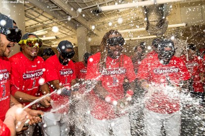 BOSTON, MA - SEPTEMBER 30: Xander Bogaerts #2, Chris Young #30, Hanley Ramirez #13, and Sandy Leon #3 celebrate in the clubhouse after clinching the American League East Division against the Houston Astros on September 30, 2017 at Fenway Park in Boston, Massachusetts. (Photo by Billie Weiss/Boston Red Sox/Getty Images) *** Local Caption *** Xander Bogaerts; Chris Young; Hanley Ramirez; Sandy Leon