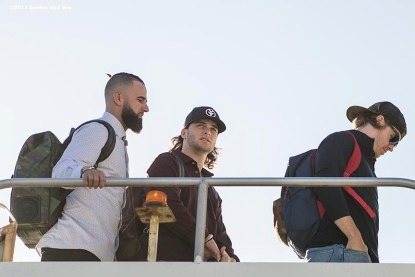 BOSTON, MA - OCTOBER 3: Deven Marrero #17, Andrew Benintendi #16, and Brock Holt #12 of the Boston Red Sox boards the plane to Houston before the American League Division Series against the Houston Astros on October 3, 2017 at Fenway Park in Boston, Massachusetts. (Photo by Billie Weiss/Boston Red Sox/Getty Images) *** Local Caption *** Deven Marrero; Andrew Benintendi; Brock Holt