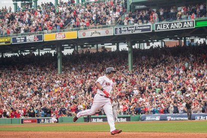 BOSTON, MA - OCTOBER 8: Rafael Devers #11 of the Boston Red Sox rounds the bases after hitting a two run home run during the third inning of game three of the American League Division Series against the Houston Astros on October 8, 2017 at Fenway Park in Boston, Massachusetts. (Photo by Billie Weiss/Boston Red Sox/Getty Images) *** Local Caption *** Rafael Devers