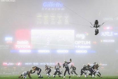 FOXBORO, MA - OCTOBER 22: Tom Brady #12 of the New England Patriots throws as fog falls on the field during the fourth quarter of a game against the Atlanta Falcons at Gillette Stadium on October 22, 2017 in Foxboro, Massachusetts. (Photo by Billie Weiss/Getty Images) *** Local Caption *** Tom Brady
