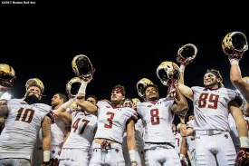 November 18, 2017, Boston, MA: Members of Boston College sing the Alma Mater after defeating University of Connecticut during the Fenway Gridiron Series presented by Your Call Football at Fenway Park in Boston, Massachusetts Saturday, November 18, 2017. (Photo by Billie Weiss/Boston Red Sox)