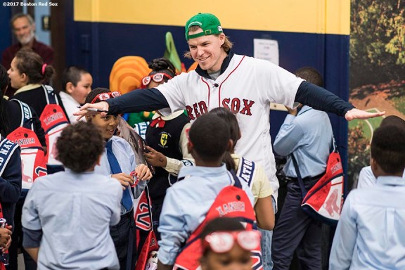 December 13, 2017, Roxbury, MA: Boston Red Sox infielder/outfielder Brock Holt reacts with students during a visit to the St. Patrick's School during The Gift Of Sox in Roxbury, Massachusetts Wednesday, December 13, 2017. (Photo by Billie Weiss/Boston Red Sox)