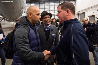 BOSTON, MA - JANUARY 30: Manager Alex Cora of the Boston Red Sox is greeted by Boston Mayor Marty Walsh inside the hangar at Boston Logan Airport during a Boston Red Sox hurricane relief trip from Boston, Massachusetts to Caguas, Puerto Rico on January 30, 2018 . (Photo by Billie Weiss/Boston Red Sox/Getty Images) *** Local Caption *** Alex Cora; Marty Walsh