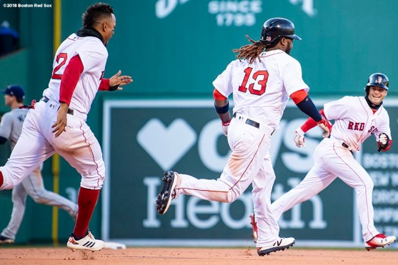 BOSTON, MA - APRIL 5: Hanley Ramirez #13 of the Boston Red Sox reacts with Xander Bogaerts #2 and Andrew Benintendi #16 after hitting a game winning walk-off single during the twelfth inning of the Opening Day game against the Tampa Bay Rays on April 5, 2018 at Fenway Park in Boston, Massachusetts. (Photo by Billie Weiss/Boston Red Sox/Getty Images) *** Local Caption *** Hanley Ramirez; Andrew Benintendi; Xander Bogaerts