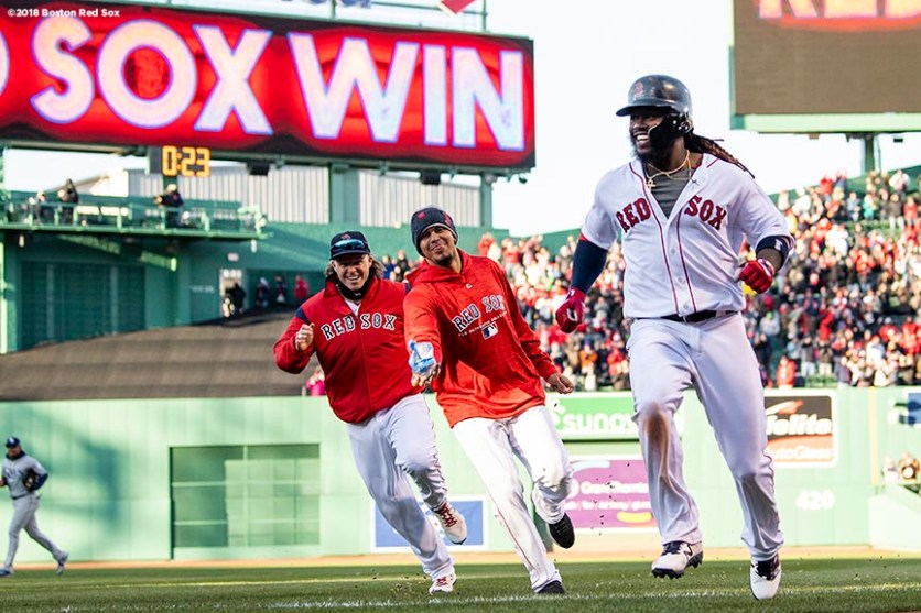 BOSTON, MA - APRIL 5: Hanley Ramirez #13 of the Boston Red Sox reacts with Brock Holt #12 and Marco Hernandez #41 after hitting a game winning walk-off single during the twelfth inning of the Opening Day game against the Tampa Bay Rays on April 5, 2018 at Fenway Park in Boston, Massachusetts. (Photo by Billie Weiss/Boston Red Sox/Getty Images) *** Local Caption *** Hanley Ramirez; Marco Hernandez; Brock Holt