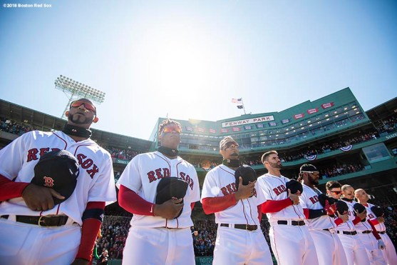 BOSTON, MA - APRIL 5: Members of the Boston Red Sox stand during the national anthem before the Opening Day game against the Tampa Bay Rays on April 5, 2018 at Fenway Park in Boston, Massachusetts. (Photo by Billie Weiss/Boston Red Sox/Getty Images) *** Local Caption ***