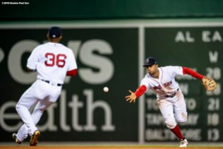 BOSTON, MA - MAY 16: Xander Bogaerts #2 flips the ball to Eduardo Nunez #36 of the Boston Red Sox as they turn a double play during the eighth inning of a game against the Oakland Athletics on May 16, 2018 at Fenway Park in Boston, Massachusetts. (Photo by Billie Weiss/Boston Red Sox/Getty Images) *** Local Caption *** Xander Bogaerts; Eduardo Nunez