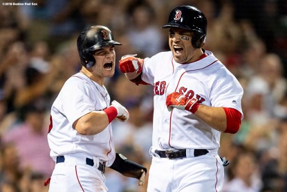 BOSTON, MA - AUGUST 2: Steve Pearce #25 of the Boston Red Sox reacts with Andrew Benintendi #16 after hitting a go ahead three run home run during the fourth inning of a game against the New York Yankees on August 2, 2018 at Fenway Park in Boston, Massachusetts. It was his second home run of the game. (Photo by Billie Weiss/Boston Red Sox/Getty Images) *** Local Caption *** Steve Pearce; Andrew Benintendi