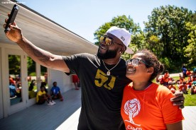 BOSTON, MA - AUGUST 2: Former designated hitter David Ortiz #34 of the Boston Red Sox poses for a selfie photograph with a camper during a visit to Camp harbor View on August 2, 2018 in Boston, Massachusetts. (Photo by Billie Weiss/Boston Red Sox/Getty Images) *** Local Caption *** David Ortiz