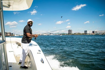 BOSTON, MA - AUGUST 2: Former designated hitter David Ortiz #34 of the Boston Red Sox fishes in the Boston Harbor as he rides a boat back after a visit to Camp Harbor View on August 2, 2018 in Boston, Massachusetts. (Photo by Billie Weiss/Boston Red Sox/Getty Images) *** Local Caption *** David Ortiz