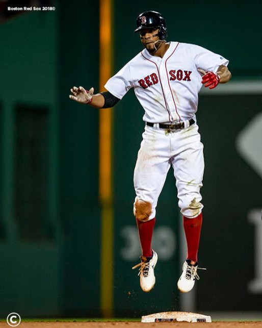 BOSTON, MA - AUGUST 21: Xander Bogaerts #2 of the Boston Red Sox reacts after hitting an RBI double during the seventh inning of a game against the Cleveland Indians on August 21, 2018 at Fenway Park in Boston, Massachusetts. (Photo by Billie Weiss/Boston Red Sox/Getty Images) *** Local Caption *** Xander Bogaerts
