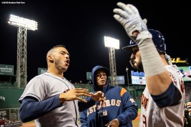 BOSTON, MA - SEPTEMBER 9: Marwin Gonzales #9 reacts with Carlos Correa #1 and Martin Maldonado #15 of the Houston Astros after hitting a solo home run during the first inning of a game against the Boston Red Sox on September 9, 2018 at Fenway Park in Boston, Massachusetts. (Photo by Billie Weiss/Boston Red Sox/Getty Images) *** Local Caption *** Marwin Gonzales; Carlos Correa; Martin Maldonado