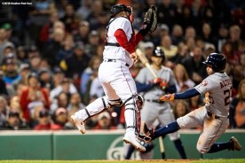 BOSTON, MA - SEPTEMBER 9: Jose Altuve #27 of the Houston Astros is tagged out at home plate by Sandy Leon #3 of the Boston Red Sox during the seventh inning of a game on September 9, 2018 at Fenway Park in Boston, Massachusetts. (Photo by Billie Weiss/Boston Red Sox/Getty Images) *** Local Caption *** Jose Altuve; Sandy Leon