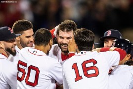 BOSTON, MA - SEPTEMBER 9: Mitch Moreland #18 of the Boston Red Sox is mobbed by teammates after hitting a game winning walk-off RBI single during the ninth inning of a game against the Houston Astros on September 9, 2018 at Fenway Park in Boston, Massachusetts. (Photo by Billie Weiss/Boston Red Sox/Getty Images) *** Local Caption *** Mitch Moreland
