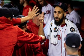 BOSTON, MA - SEPTEMBER 12: David Price #24 of the Boston Red Sox high fives teammates before a game against the Toronto Blue Jays on September 12, 2018 at Fenway Park in Boston, Massachusetts. (Photo by Billie Weiss/Boston Red Sox/Getty Images) *** Local Caption *** David Price